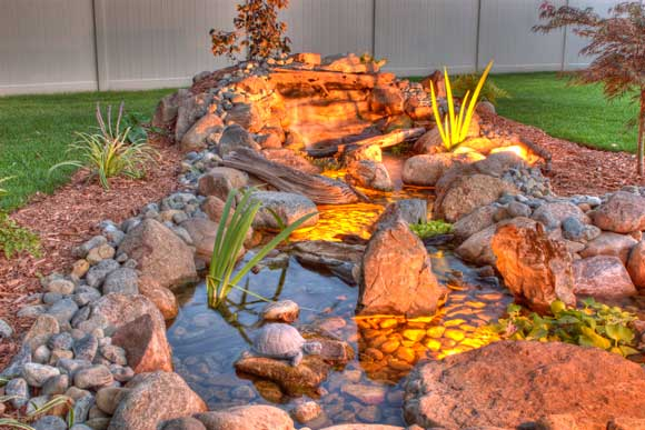 Pondless water feature with a low voltage lighting system